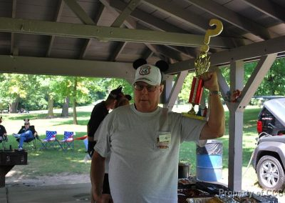 "Bruce WINNER of the ""Useless Information"" Quiz received the 1st of the tacky trophies awarded at the picnic."