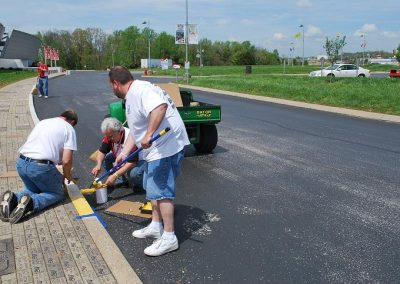 The following club members volunteered to be the curb brigade: Ken O., Mark W., Robert S., Rich R., and Steve B. painted the curb the official curb yellow. This was the starting point near the Corvette entrance and continued across the front of the Museum to the temporary construction fence on the back side of the Museum near the Spire.